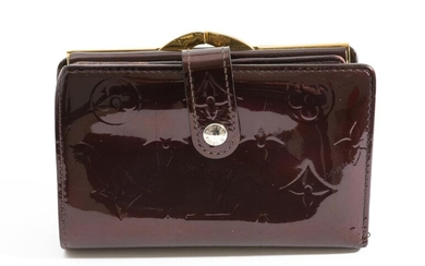 A FRENCH PURSE BY LOUIS VUITTON-Styled in dark red monogram Vernis leather with golden brass hardware, 13.5 x 9 x 3cm.