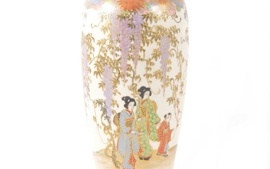 A Japanese Satsuma slender vase decorated with figures and trailing wisteria.