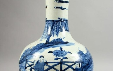 A LARGE CHINESE BLUE AND WHITE BOTTLE VASE. 14ins