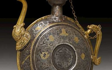 A LARGE SILVER AND GOLD DAMASCENED IRON BEER JUG.