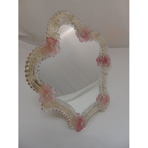 A Murano glass dressing table mirror with applied pink flowe...