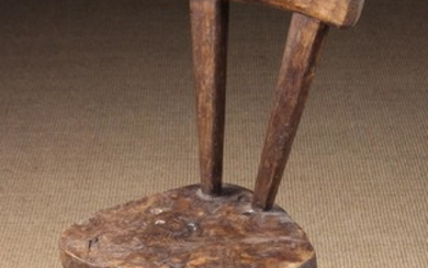 A Primitive French Rustic Chair. The back with cross rail nailed to two splayed uprights tapering do