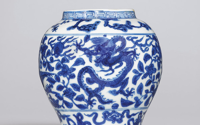 A RARE BLUE AND WHITE 'DRAGON AND PHOENIX' JAR, WANLI SIX-CHARACTER MARK IN UNDERGLAZE BLUE WITHIN A DOUBLE CIRCLE AND OF THE PERIOD (1573-1619)