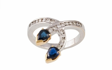 A SAPPHIRE AND DIAMOND DRESS RING, with sapphires of approx ...