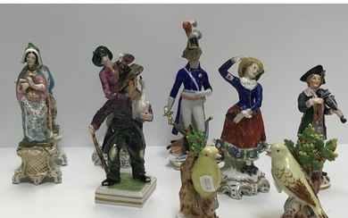 A collection of Continental porcelain figures including a pa...
