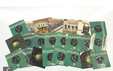 A collection of The Beatles 7 inch singles and EPs to includ...