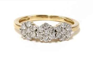 A gold diamond triple cluster ring
