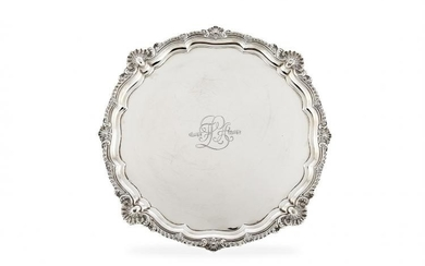 A large Edwardian silver shaped circular salver by Harrison Brothers & Howson