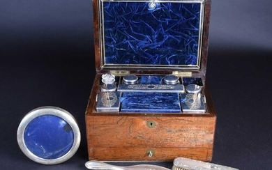 A matched silver-backed dressing table set, comprising a mir...