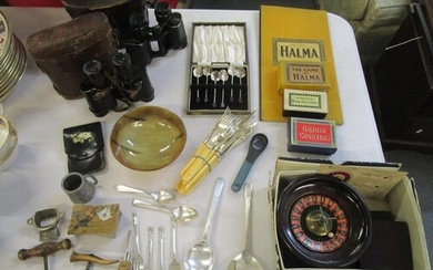 A mixed lot of games, flatware, binoculars and other items t...