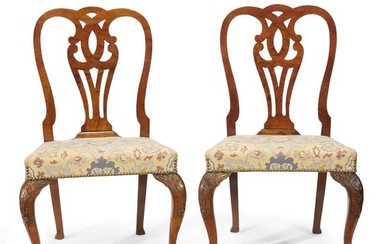 A pair of George I carved walnut side chairs...