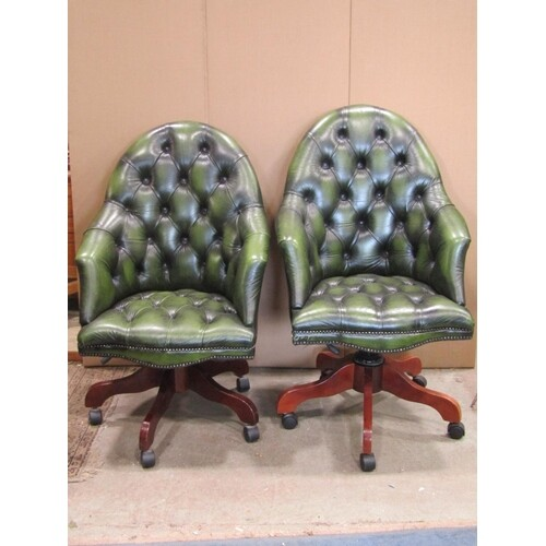 A pair of reproduction buttoned green leather upholstered sp...