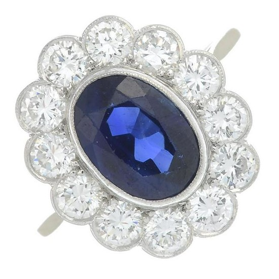A sapphire and diamond cluster ring. Sapphire