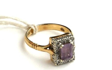 AN EDWARDIAN STYLE 9CT GOLD, AMETHYST AND DIAMOND DRESS RING...
