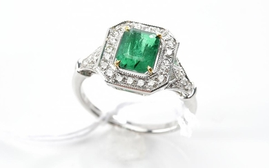 AN EMERALD AND DIAMOND DRESS RING - Featuring an emerald cut emerald weighing 1.10ct, surrounded and shouldered by round brilliant c...