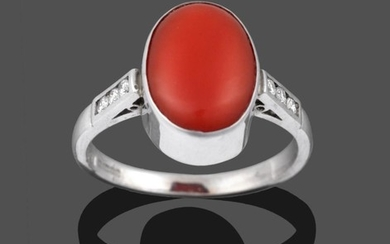 An 18 Carat White Gold Coral and Diamond Ring, the...