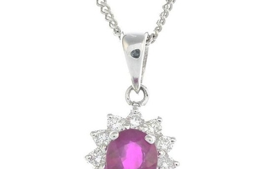 An 18ct gold ruby and diamond cluster pendant