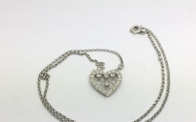 An 18ct white gold diamond set heart shaped pendant on chain...