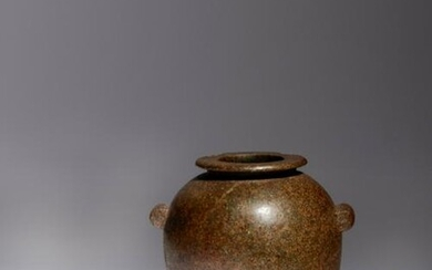 An Egyptian Granite Jar Height 3 1/4 inches.