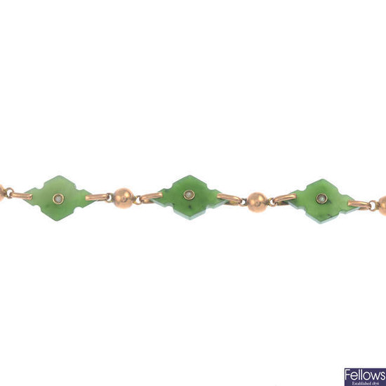 An early 20th century gold nephrite jade and split pearl bracelet.