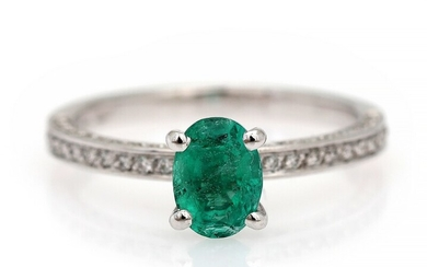 NOT SOLD. An emerald and diamond ring set with an emerald encircled by numerous diamonds,...