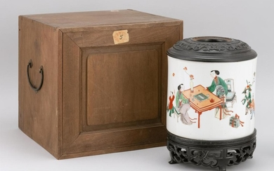 """CHINESE FAMILLE VERTE PORCELAIN BRUSH POT Depicting figures engaged in various pursuits. Wood cover. Height 8"""". With carved wood sta..."""