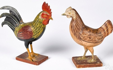 Carved and painted rooster and hen