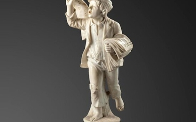 Garden statues: A carved white marble figure of a boy selling newspapers