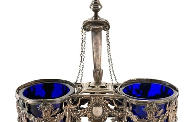 LOUIS XVI SILVER DOUBLE-SALT CELLAR Maker's mark rubbed. Central chained pedestal above frames with neoclassical motifs. Oval cobalt..