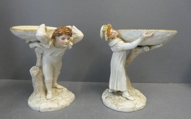 Pair of Worcester figures with a young man and girl supporti...