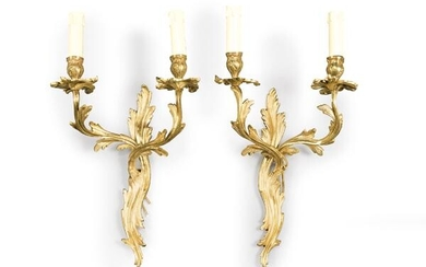 Pair of rococo style gilt bronze wall lights, France