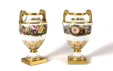 Sèvres Pair of royal vases called Clodion vases of the third size in Sèvres porcelain of the Charles X period, dated 1827-28, with polychrome decoration of large garlands of flowers, gold decoration of a frieze of palmettes, foliage and foliage scrolls...