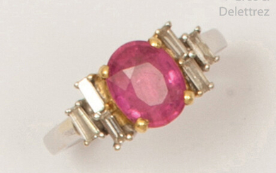 White and yellow gold ring set with an...