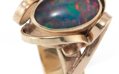 A 9CT GOLD OPAL RING; rub set with an opal triplet with applied flat wire ribbons, size O1/2, wt. 3.21g.