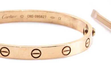 A CARTIER 18CT GOLD LOVE BANGLE; 6mm wide 2 piece bangle marked Cartier CRD095827, size 16, internal diam. 54 x 44mm, with gold plat...