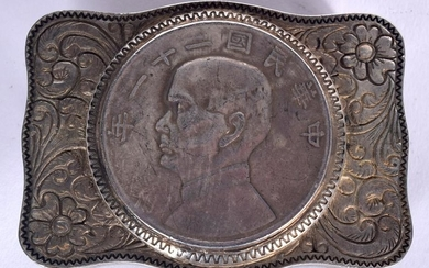 A CHINESE WHITE METAL BELT BUCKLE, decorated with a