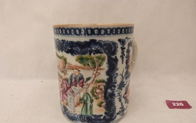 A Chinese blue and white porcelain mug, painted in coloured ...