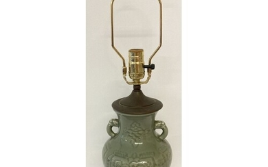 A Chinese celadon glazed, 2 handled lamp base with floral de...