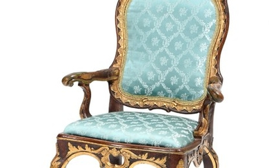 A Danish 18th century partly painted and gilded beech Rococo armchair, richly carved with rocailles and foliage.