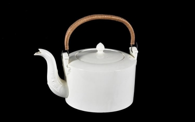 A English creamware punch kettle with wicker handle