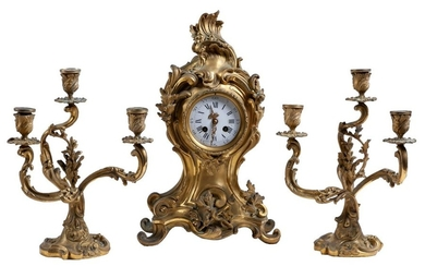A French gilded bronze garniture comprising a tablecloth...