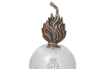 A GEORGE V SILVER GRENADE TABLE LIGHTER, MARK OF GOLDSMITHS & SILVERSMITHS CO. LTD., LONDON, 1935