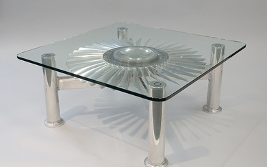 A MODERN STAINLESS STEEL AND GLASS TABLE FEATURING A JET ENGINE TURBINE, CIRCA 1960s