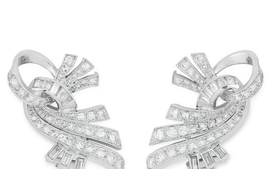 A PAIR OF DIAMOND CLIP EARRINGS set with round and