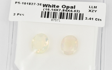A PAIR OF LOOSE WHITE OPALS