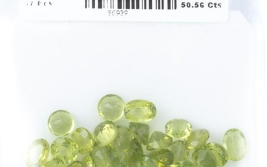 A PARCEL OF UNSET PERIDOTS; 57 round and oval cut gemstones totalling 50.56ct.