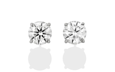 A Pair of Diamond Solitaire Earrings, the round brilliant cut...