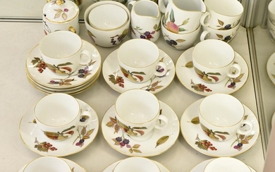 A ROYAL WORCESTER 'EVESHAM' TEA SET COMPRISING THIRTEEN CUPS AND TWELVE SAUCERS, MILK JUGS AND TWO SUGAR BOWLS