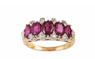 A RUBY AND DIAMOND DRESS RING, the oval graduating rubies to...