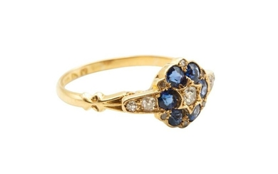 A SAPPHIRE AND DIAMOND CLUSTER RING, CIRCA 1923